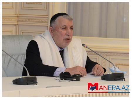 Dövlət başçısı dini icma sədrini təltif edib